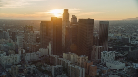 AX0162_088.0000000 - Aerial stock photo of Tall city skyscrapers of downtown at sunset in Downtown Los Angeles, California