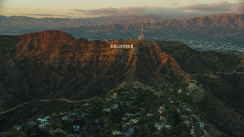 AX0162_101.0000000 - Aerial stock photo of The Hollywood Sign at twilight in Los Angeles, California