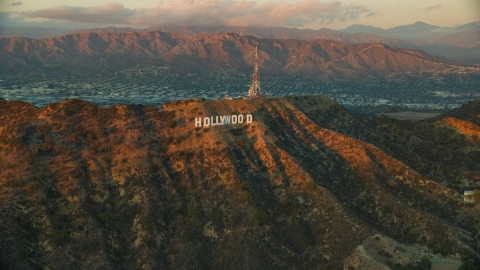 AX0162_102.0000000 - Aerial stock photo of The famous Hollywood Sign at twilight in Los Angeles, California