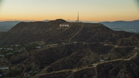 AX0162_107.0000000 - Aerial stock photo of The world famous Hollywood Sign at twilight in Los Angeles, California