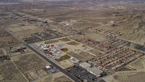 AX06_101.0000099 - Aerial stock photo of Small neighborhoods in the desert in Rosamond, California
