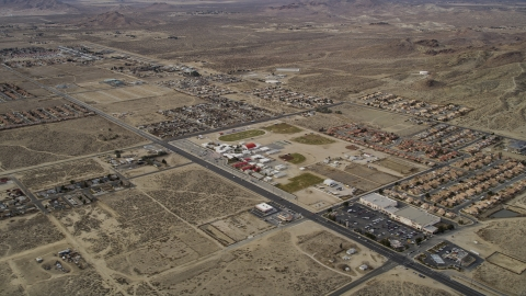 AX06_101.0000199 - Aerial stock photo of Neighborhoods in a desert town in Rosamond, California