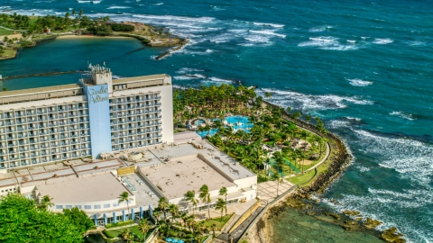 AX101_004.0000229F - Aerial stock photo of An oceanside resort hotel in the Caribbean, San Juan, Puerto Rico