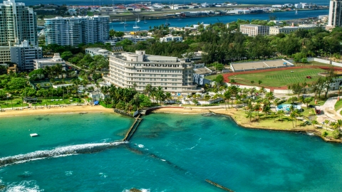 AX101_006.0000226F - Aerial stock photo of Waterfront Normandie Hotel in San Juan, Puerto Rico