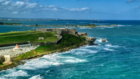 AX101_011.0000000F - Aerial stock photo of Historic fort on the coast by clear blue water, Old San Juan, Puerto Rico