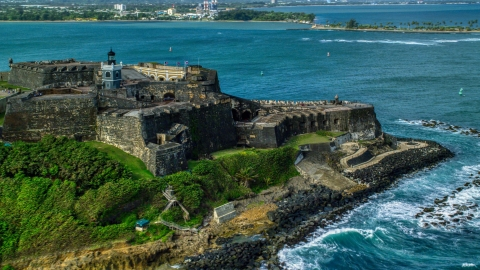 AX101_012.0000125F - Aerial stock photo of Historic fort along the coast with clear blue water, Old San Juan Puerto Rico