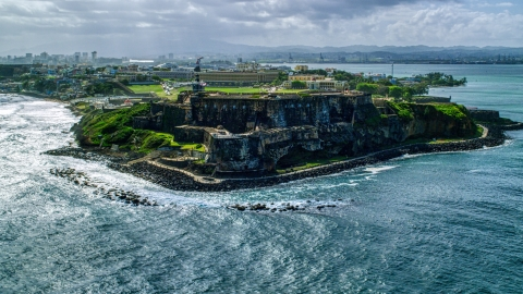 AX101_014.0000000F - Aerial stock photo of Historic fort on the coast, Old San Juan, Puerto Rico