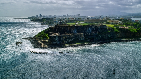AX101_014.0000165F - Aerial stock photo of Coastal historic fort in Old San Juan, Puerto Rico
