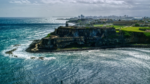 AX101_015.0000000F - Aerial stock photo of Historic fort on the coast with clear blue water, Old San Juan, Puerto Rico