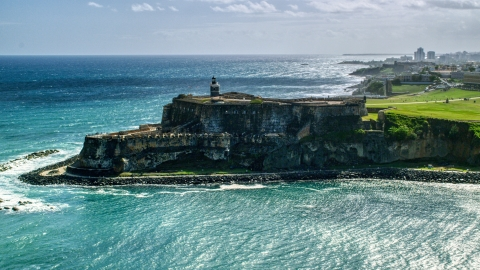 AX101_015.0000162F - Aerial stock photo of Fort San Felipe del Morro overlooking the sea in Old San Juan, Puerto Rico