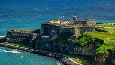 AX101_016.0000189F - Aerial stock photo of Fort San Felipe del Morro, a Caribbean fort, in Old San Juan, Puerto Rico