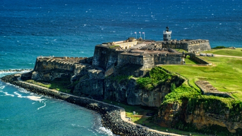 AX101_017.0000000F - Aerial stock photo of Historic fort overlooking the blue waters of the Caribbean, Old San Juan, Puerto Rico