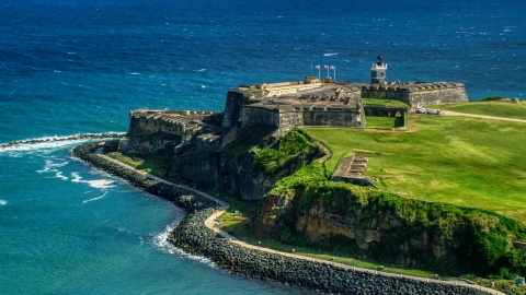 AX101_017.0000136F - Aerial stock photo of The seaside Fort San Felipe del Morro in Old San Juan, Puerto Rico