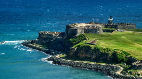AX101_018.0000000F - Aerial stock photo of Historic fort on the coast by the blue waters of the Caribbean, Old San Juan, Puerto Rico
