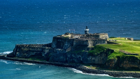 AX101_019.0000203F - Aerial stock photo of Castillo San Felipe del Morro by blue Caribbean waters, Old San Juan, Puerto Rico