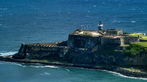 AX101_020.0000163F - Aerial stock photo of Historic fort on the coast in the blue Caribbean waters, Old San Juan Puerto Rico