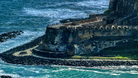 AX101_021.0000232F - Aerial stock photo of Historic Caribbean fort with tourists, Old San Juan, Puerto Rico