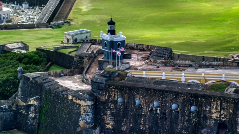 AX101_023.0000000F - Aerial stock photo of Castillo San Felipe del Morro lighthouse, Old San Juan, Puerto Rico