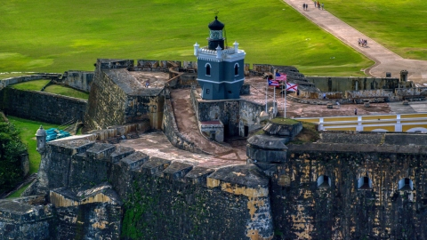 AX101_023.0000208F - Aerial stock photo of Historic Caribbean fort and lighthouse, Old San Juan, Puerto Rico