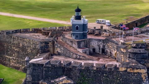 AX101_024.0000203F - Aerial stock photo of Historic fort and lighthouse, Old San Juan Puerto Rico