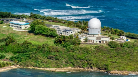 AX101_029.0000000F - Aerial stock photo of Punta Salinas Radar Site overlooking the blue waters of the Caribbean, Toa Baja, Puerto Rico