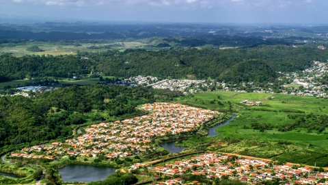 AX101_034.0000000F - Aerial stock photo of Rural neighborhoods near forests, Dorado, Puerto Rico Day