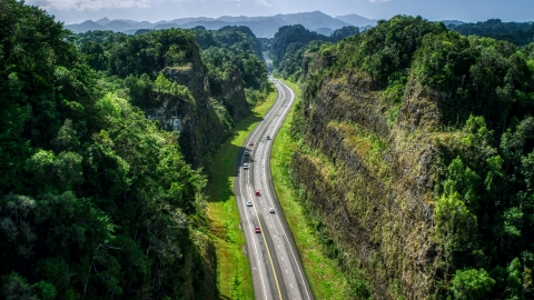 AX101_083.0000200F - Aerial stock photo of A highway through lush green mountains, Karst Forest, Puerto Rico