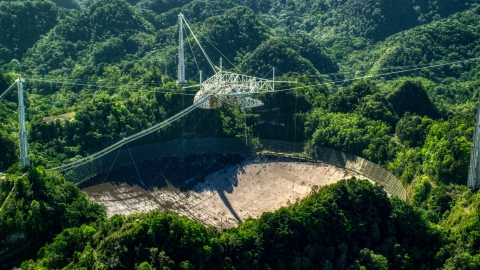 AX101_094.0000000F - Aerial stock photo of The Arecibo Observatory surrounded by the Karst forest, Puerto Rico