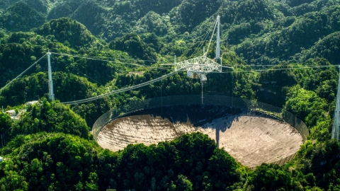 AX101_095.0000000F - Aerial stock photo of Arecibo Observatory dish and Karst forest, Puerto Rico