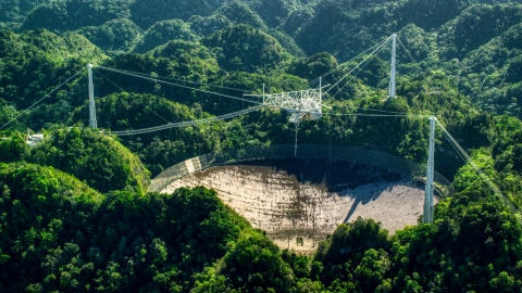AX101_096.0000000F - Aerial stock photo of Arecibo Observatory in lush green Karst forest, Puerto Rico