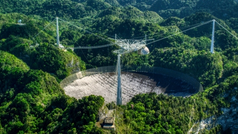 AX101_097.0000149F - Aerial stock photo of The Arecibo Observatory in Puerto Rico