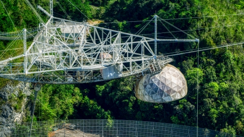 AX101_099.0000000F - Aerial stock photo of The top structure of the Arecibo Observatory, Puerto Rico