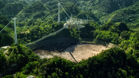 AX101_106.0000000F - Aerial stock photo of Arecibo Observatory surrounded by Karst Forest trees in Puerto Rico