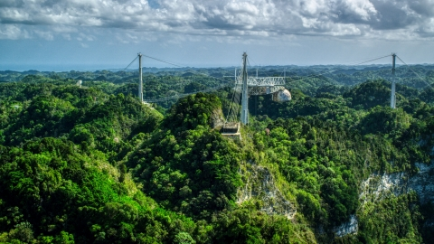 AX101_110.0000247F - Aerial stock photo of A view over lush jungle of the Arecibo Observatory, Puerto Rico