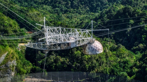 AX101_112.0000000F - Aerial stock photo of The top structure of the Arecibo Observatory in Puerto Rico