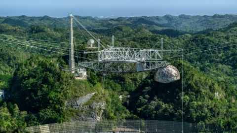 AX101_113.0000000F - Aerial stock photo of Top of the Arecibo Observatory and lush green trees, Puerto Rico