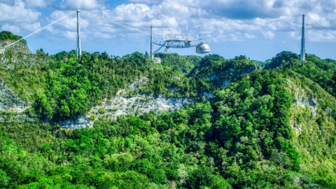 AX101_114.0000000F - Aerial stock photo of Top of the Arecibo Observatory seen above karst mountains, Puerto Rico