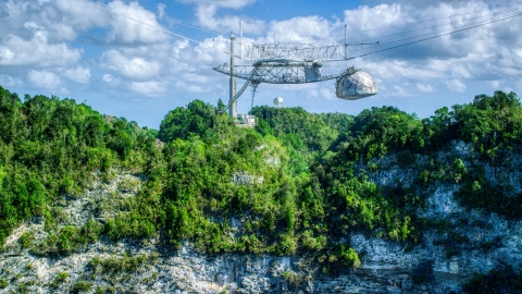 AX101_116.0000000F - Aerial stock photo of Top structure of the Arecibo Observatory and karst mountains in Puerto Rico