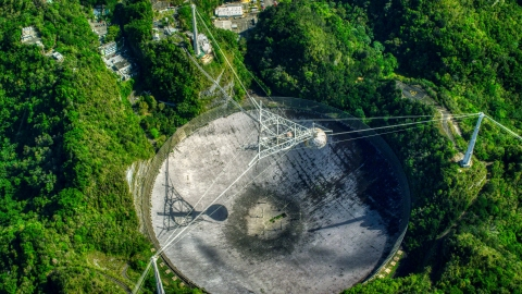 AX101_121.0000000F - Aerial stock photo of A bird's eye of the Arecibo Observatory in Puerto Rico