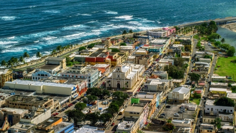 AX101_138.0000000F - Aerial stock photo of Coastal buildings and Catedral San Felipe, Arecibo Puerto Rico