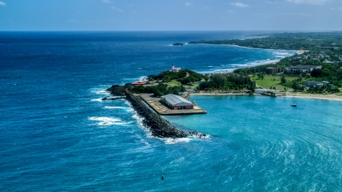 AX101_141.0000000F - Aerial stock photo of The Arecibo Lighthouse overlooking the blue Caribbean waters, Puerto Rico