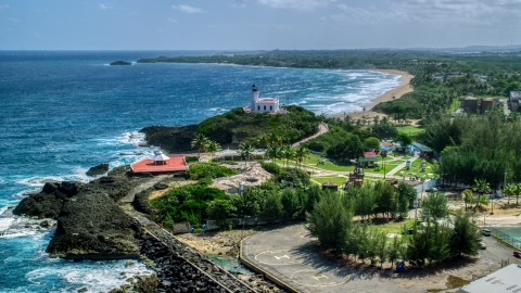 AX101_143.0000000F - Aerial stock photo of Arecibo Lighthouse on a small hill overlooking the Caribbean, Puerto Rico
