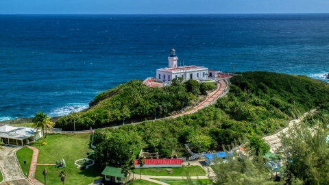 AX101_144.0000000F - Aerial stock photo of Arecibo Lighthouse with a view of the coastal waters of the Caribbean, Puerto Rico