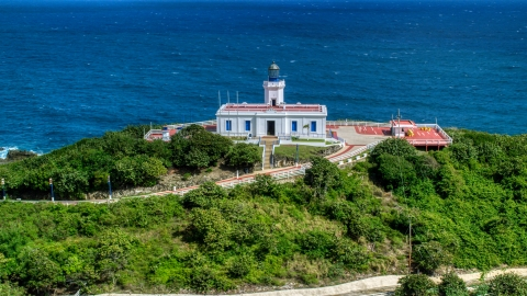AX101_144.0000277F - Aerial stock photo of Arecibo Lighthouse beside the coastal waters of the Caribbean, Puerto Rico