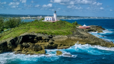 AX101_147.0000000F - Aerial stock photo of Arecibo Lighthouse on the Caribbean island coast, Puerto Rico