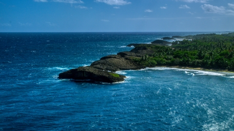 AX101_160.0000000F - Aerial stock photo of Rounded rock formations along the coast in Arecibo, Puerto Rico