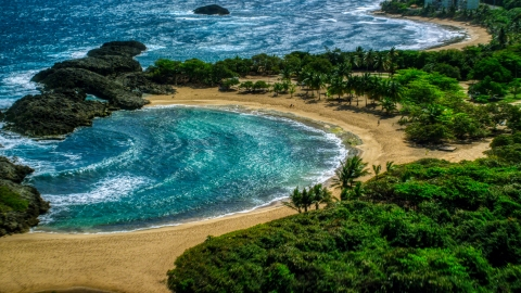 AX101_190.0000167F - Aerial stock photo of Coastal tide pool and beach in Manati, Puerto Rico