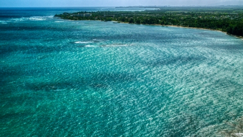 AX101_215.0000300F - Aerial stock photo of Private resort and beach across beautiful blue water of a bay, Dorado, Puerto Rico