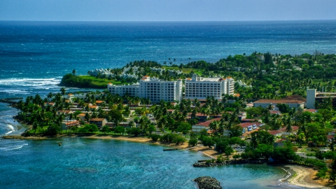 AX101_217.0000000F - Aerial stock photo of Coastal hotel by pristine blue water, Dorado, Puerto Rico
