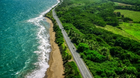 AX101_225.0000241F - Aerial stock photo of A Caribbean island beach and highway in Dorado, Puerto Rico